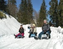 Family enjoying winter activities in Switzerland