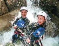 Girl Canyoning in Summer in Switzerland