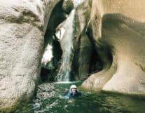 Girl under Waterfall inside Canyon Chli Schliere