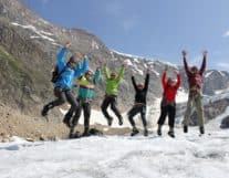 Tourist group exploring glaciers in Switzerland