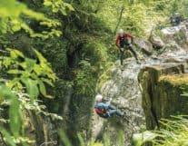 Guy rapelling canyon in interlaken