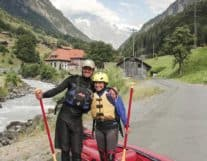 Instructor and Girl wearing rafting equipments