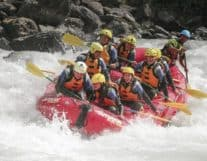 Group of tourists River Rafting in Lutschine