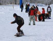 Kid learning snowboard at Jungfrau Region
