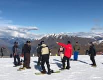 Tourists in Interlaken learning snowboard