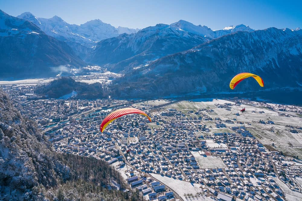 Paragliding over Interlaken on winter season