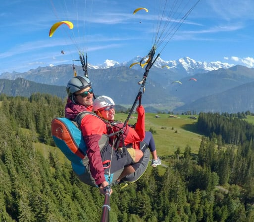 Tandem paragliding with beautiful view of Swiss Alps