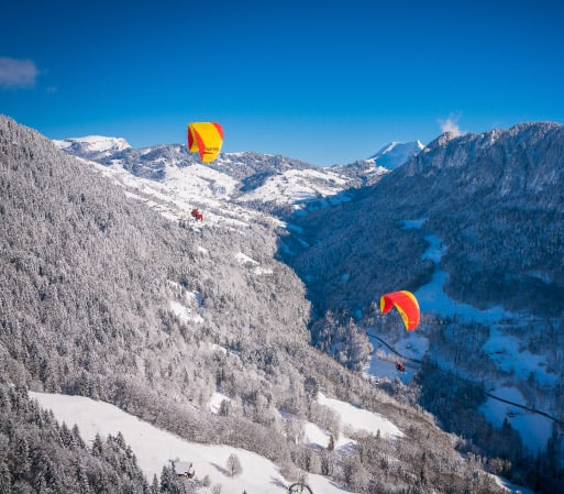 Paragliders in Interlaken Region on Winter