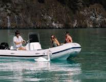 Family enjoying summer in a boat in Interlaken Switzerland