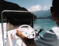 driving a motor boat in Lake of Thun